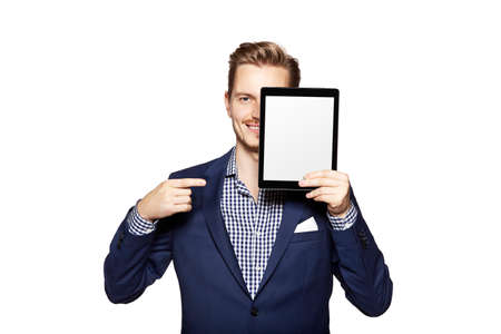 copy sapce: Portrait of a cheerful young man is showing something on digital tablet. Stock Photo