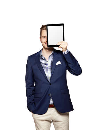 copy sapce: Portrait of a cheerful young businessman holding a blank digital tablet.