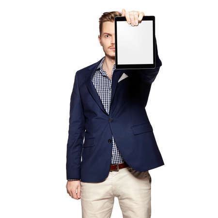 blank tablet: Portrait of young businessman holding a blank digital tablet.