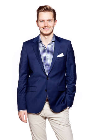facial expression: Portrait of a happy young man standing against isolated white background