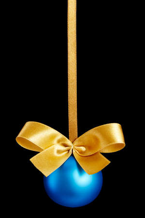 Blue Christmas ball with bow on black background Stock Photo