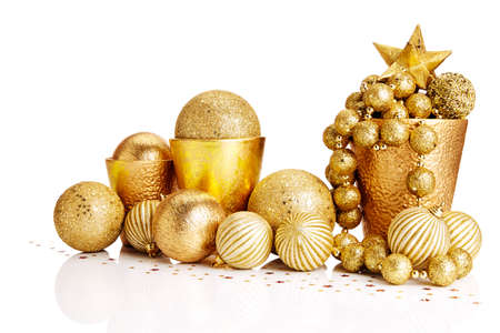 christmas decorations with white background: Composition of gold Christmas decorations on white background. Stock Photo