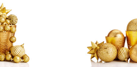 christmas balls: Composition of gold Christmas decorations on white background. White copy space.