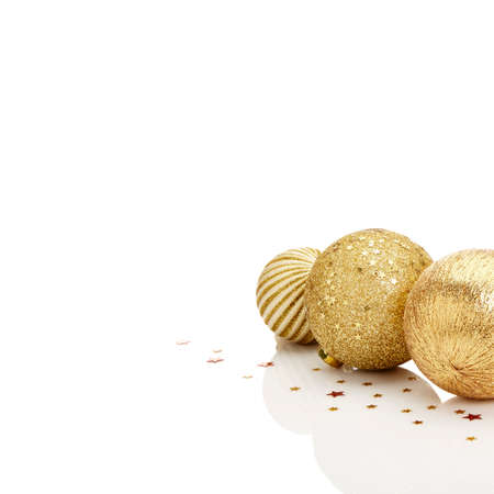 group of christmas baubles: Gold Christmas balls with stars on white background. A lot of white copy space. Stock Photo