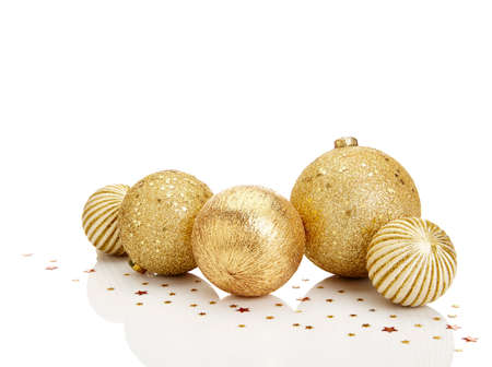 orbs: Gold Christmas balls with stars on white background. Copy Space.