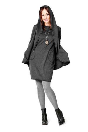 full shot: Beautiful young woman posing in a gray dress. Look book fashion.