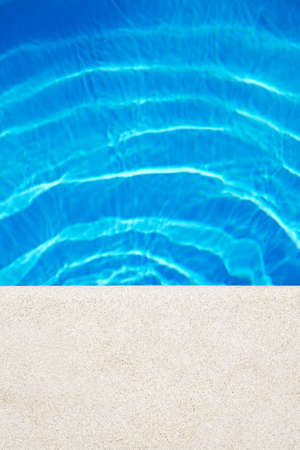 Swimming pool edge at the sunny day. Vacation background. Copy Space