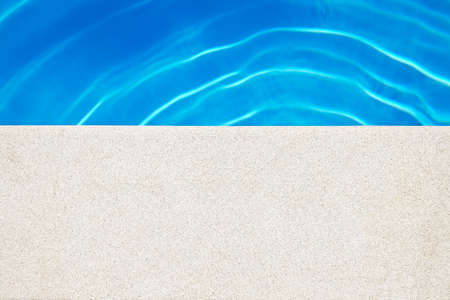 water's edge: Swimming pool edge at the sunny day. Vacation background. Copy Space