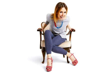 person sitting: Mujer sentada en una silla vieja escuela y la risa
