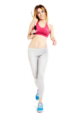 sportswoman: Studio shot of attractive sportswoman is walking against white background. Stock Photo