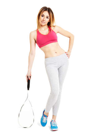Sportswoman posing with a tennis racket. Isolated on white background Stock Photo