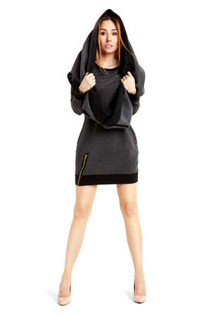 full shot: Full length portrait of young sexy woman in a black mini dress and cape.