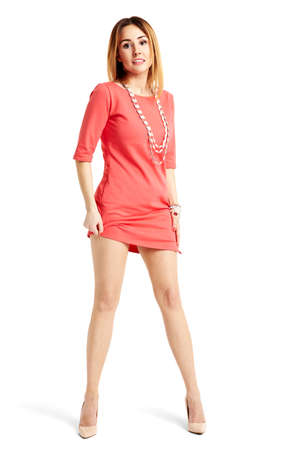 shapely legs: Full length portrait of sensual woman in red dress. She has really shapely legs.