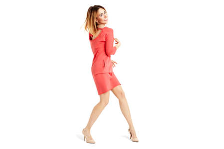 rotates: Full length portrait of woman in a red dress.