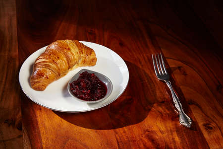 second breakfast: Croissants with jam for breakfast on wooden table. Copy space.
