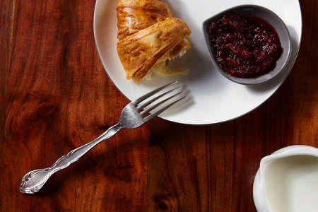 second breakfast: Croissants with jam for breakfast on wooden table. View from above.