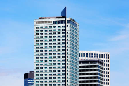 intercontinental: Top of high-rise business office building on blue sky. InterContinental hotel, Warsaw, Poland.