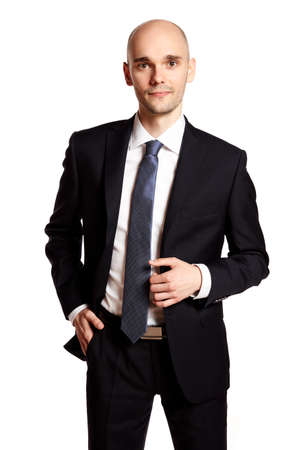 Studio portrait of elegant man in black suit. Stock Photo