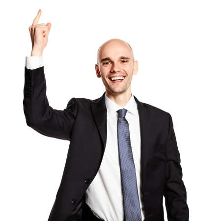 Studio shot of happy young man gesturing with his hand. Isolated on white background.