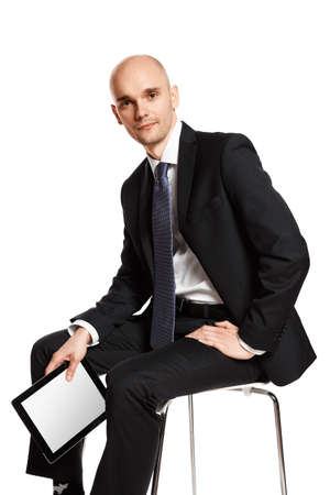 Portrait of young businessman sitting on chair. Studio shot isolated on white background. Stock Photo
