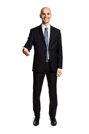 Smiling man greets you. Portrait of man in suit isolated on white background.