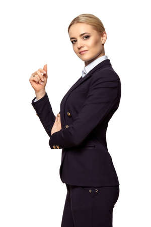 Studio portrait of a serious blonde business woman with raised hand. Isolated on white background. Stock Photo