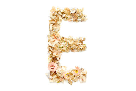 Letter E made from coloured pencil shavings for use in your design. Reklamní fotografie