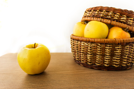 bushel: Fresh apples in basket on wooden background Stock Photo