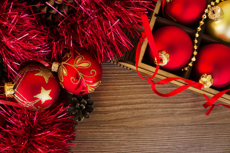 Christmas card with red and gold balls on the wooden table photo