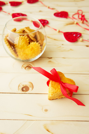 Card with Cookies in the Shape of Heart at Valentine Day photo