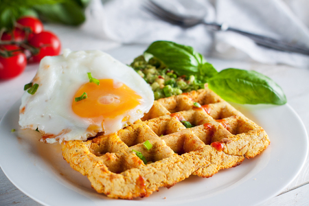 Fresh baked sweet potato waffles with scrambled eggs and avocado dip. Healthy breakfast 스톡 콘텐츠