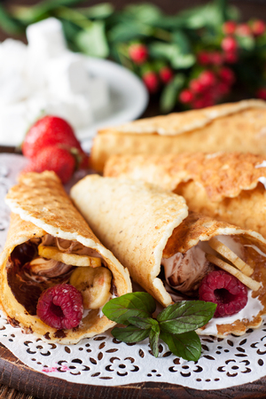 Delicious Campfire Cones filled marshmallow, chocolate, banana chips and fresh berries