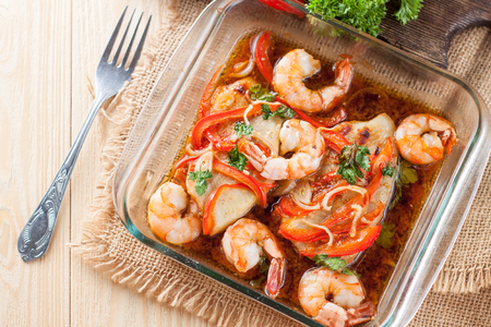 Healthy seafood dish - tilapia fillets baked with shrimps and vegetables 스톡 콘텐츠 - 113955745
