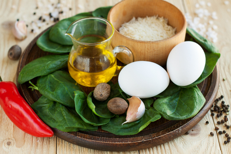 Ingredients for healthy breakfast - scrambled eggs with spinach and parmesan cheese 스톡 콘텐츠 - 113955750