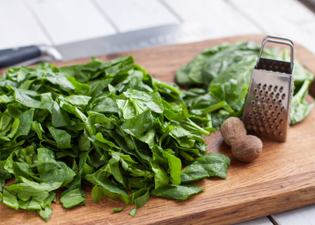 Preparation of scrambled eggs with spinach - chopped spinach leaves and nutmeg