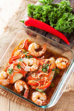 Healthy seafood dish - tilapia fillets baked with shrimps and vegetables 스톡 콘텐츠 - 113954234