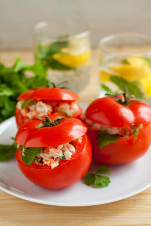Fresh ripe tomatoes stuffed with canned tuna and vegetables