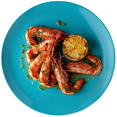 Jumbo shrimps (head on) with grilled lemon and garlic and citrus sauce, top view