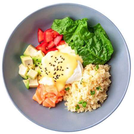 Healthy vegetable buddha bowl lunch with salmon, feta cheese and couscous, spinach, avocado, tomatoes. Top view. Isolated on white background. 스톡 콘텐츠