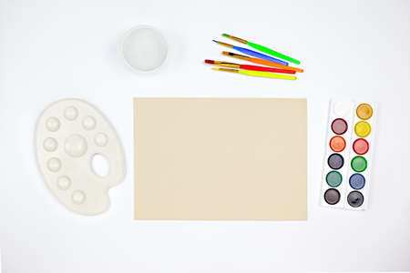 Artist workspace with watercolor palette, brushes and paper Stock Photo