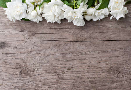 Jasmine flowers on a wooden table. Place for your text. Copy space 版權商用圖片