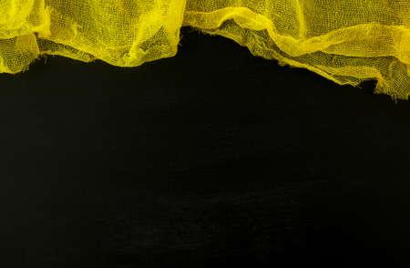 Yellow gauze on black chalkboard table