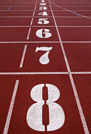 Numbers of running track. Close up. Selective focus. Vertical image