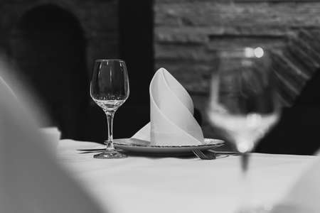 Empty glasses set in restaurant. Black and white picture
