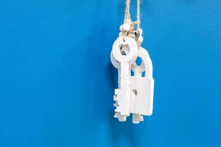 Decorative wooden keys on a blue background 免版税图像