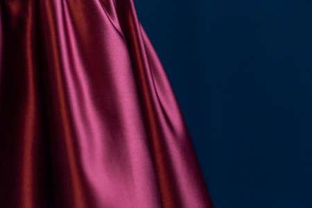 Burgundy dress. Close up. Selective focus. Copy space