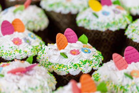 Traditional Ukrainian Easter cake Paska, decorated meringue and candy. Easter bread. Selective focus