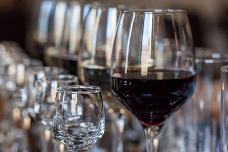 White and red wine in glasses on a buffet table