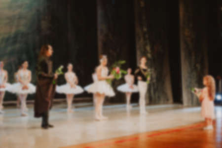 Abstract blurred backgroud. Ballet dancers dance on the stage