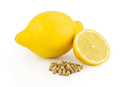 Sliced ripe lemon and white pepper isolated